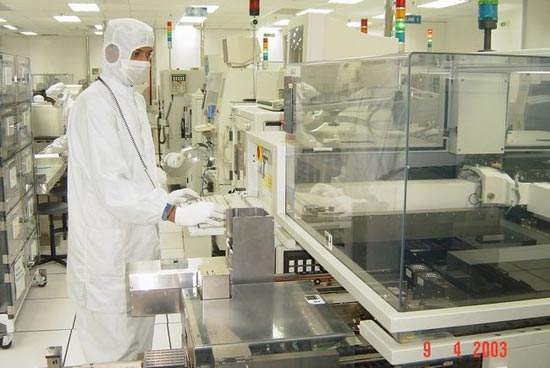 Engineer attending to Micron machine (pick and place of die to substrate).