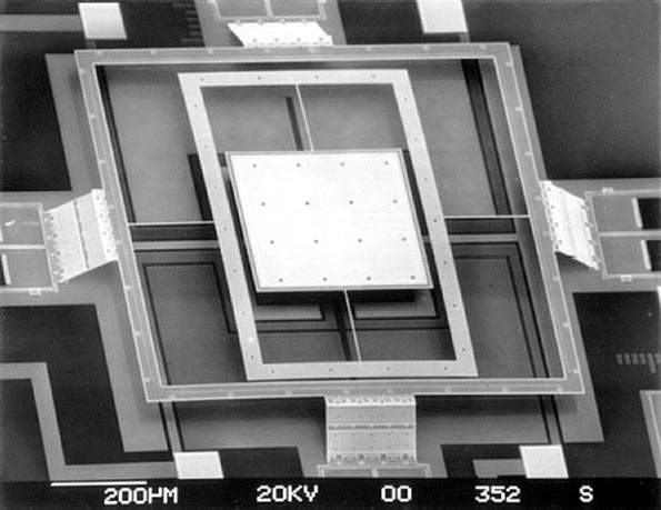 MEMS structures are built using thin material films, using deposition, photolitho and etching. This 2D scanner was photographed by Ming C. Wu, UCLA Electrical Engineering Dept.